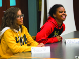 Two Northeast Ohio Students sitting at a desk during meeting.